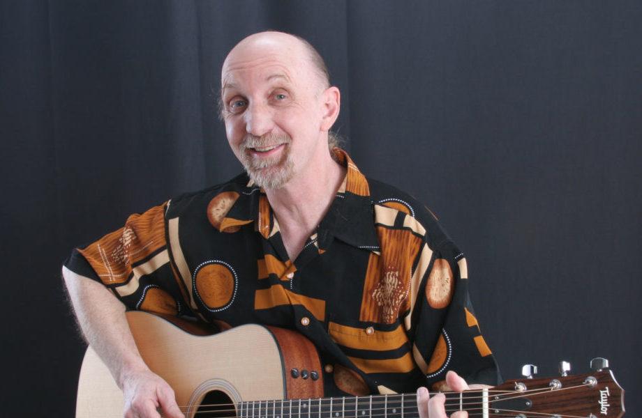 Paul Arow with Taylor Guitar